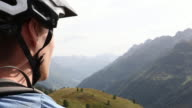 Profile of mountain biker as he descends trail