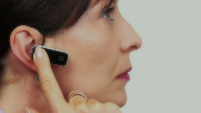 CU, Profile of woman using mobile phone Bluetooth device