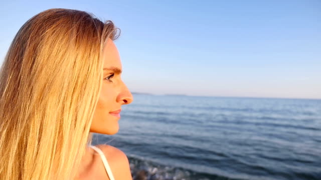 Profile view of woman looking at sea view