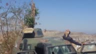 Progovernment forces were still fighting on Sunday against Huthi rebels on the outskirts of Taez