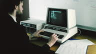 1982 MONTAGE Program developer typing on computer and monitor displaying information / United Kingdom