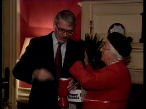 Progress on AngloIrish talks ENGLAND London 10 Downing Street Woman pinning poppy to PM John Major's lapel as the 2 then stand for photocall CMS...