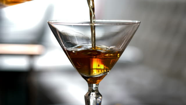 Prohibition Style Mixed Drink Cocktail being poured