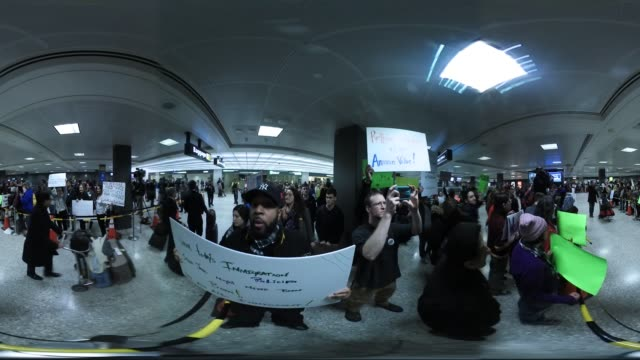 Proimmigrant protesters welcome travelers who arrive at Dulles International Airport Protests were staged at airports across the country and other...