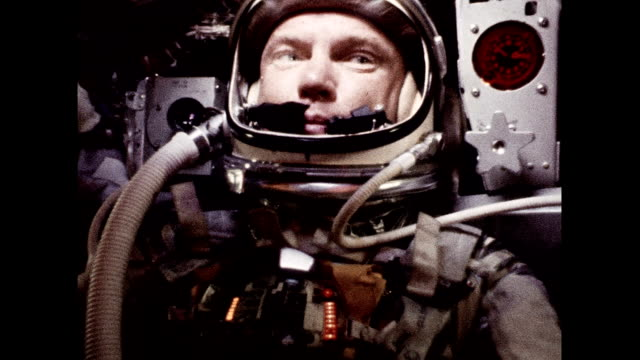 Project Mercury astronaut John Glenn as seen from onboard camera Mercury Control Center tracking chart and countdown clock Astronaut John Glenn in...