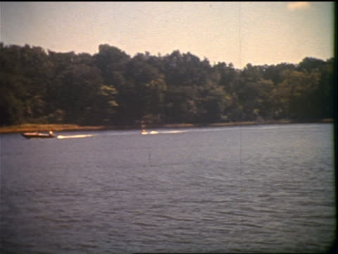 Projected film of boat on lake / film burns