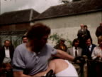Men stage boxing match to decide price of house ENGLAND Sussex Battle EXT Kevin Reardon and John Naylor fighting in boxing gloves in makeshift ring...