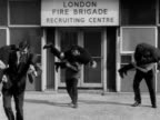 Prospective firemen are tested by carrying men at the London Fire Brigade recruiting centre
