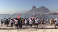A protest is held in Rio de Janeiro against pollution in Guanabara Bay where the 2016 Olympics sailing competition will take place
