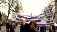 Protest march and rally against legal aid cuts ENGLAND London Westminster EXT Crowd of protesters / effigy of Chris Grayling MP being held up **Music...