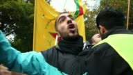 A protester shouts slogans during a demonstration near the Turkish Embassy by mostly expatriate Kurds demanding aid for Kurdish forces in the...