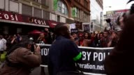 Protesters against police violence march in Manhattan on April 14 2015 in New York City A coalition of anti police violence and anti racist...