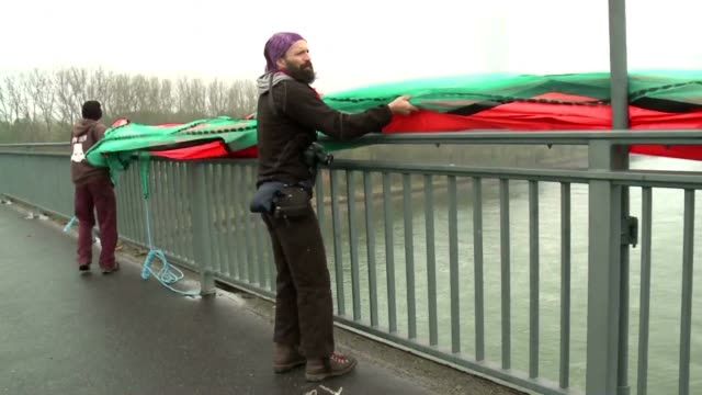 Protesters attempted to hang an anti Trump banner from a bridge close to Bonn where the COP23 climate talks are taking place but were stopped by...
