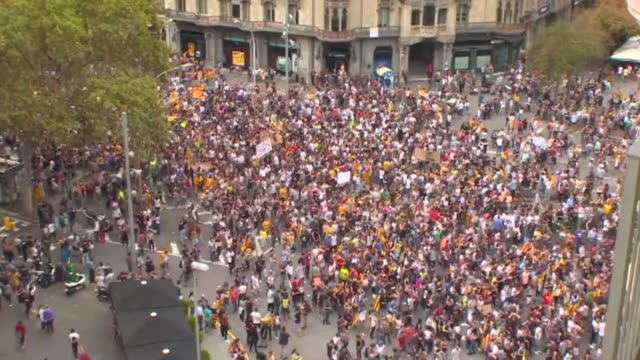 Protesters blocked roads public transport slowed to a crawl and FC Barcelona refused to train on Tuesday as Catalonia observed a general strike over...