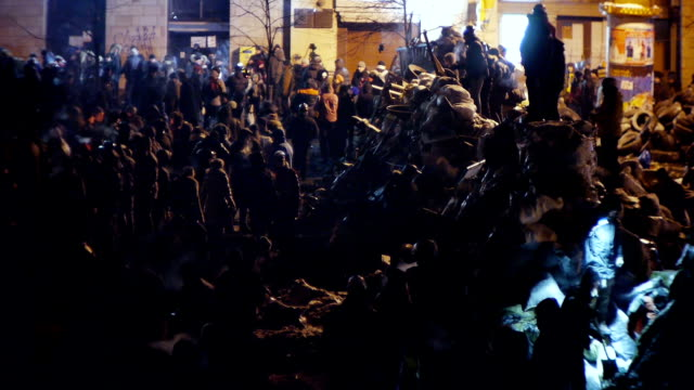 Protesters build barricades at night during riot