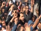 Protesters chant at an antiGaddafi demonstration during the uprising in Libya