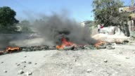 Protesters clashed with each other and police in the Haitian capital Monday amid demonstrations against high oil prices that saw three people wounded...