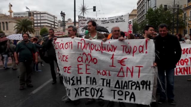 Protesters demanding cancelations of the Greece's debts received from EU shout slogans during an antiEuropean Union march in Athens on May 11 2015