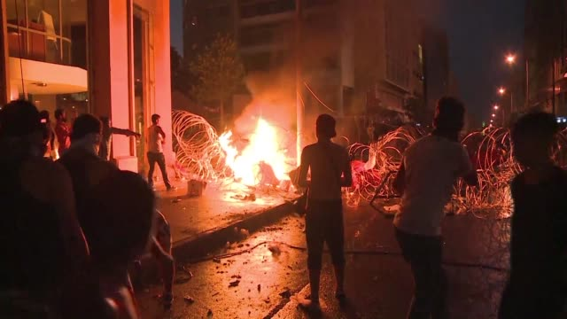 Protesters demanding the Lebanese government resign over its failure to remove uncollected rubbish from the streets clashed on Sunday with police in...