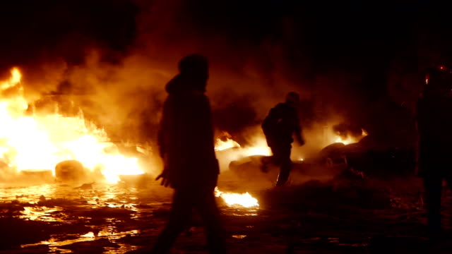 Protesters during riot - flames everywhere
