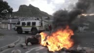 Protesters from the Hangberg community clash with South African police during protests in Cape Town over fishing rights