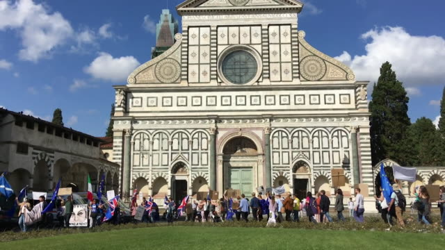 Protesters gather outside the venue of Theresa May's Florence speech Santa Maria Novella church to ask that she protects the rights of British...