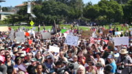 Protesters gather to listen to speakers during the Bay Area Against Hate rally near the Crescent at UC Berkeley in Berkeley California Several...