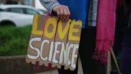 Protesters gather to protest against the Trump administration's environmental policies during a rally coinciding with March for Science protest...