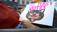 Protesters gathered outside of Trump Tower on 5th Avenue and dubbed the protest 'Pussy Power at Trump Tower' in opposition of Donald Trump's...