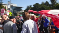 Protesters hold a banner during the Bay Area Against Hate rally near the Crescent at UC Berkeley in Berkeley California Several thousand attended the...