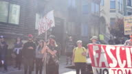 Protesters hold a banner reading 'Fascism Not Welcome No to White Supremacy' near Alamo Square in San Francisco California where protesters gathered...