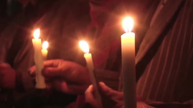 Protesters hold a candlelight vigil in the southwestern city of Quetta for the 21 people killed when heavily armed gunmen stormed a university in...