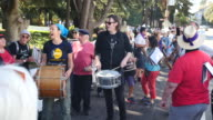 Protesters in a band play 'We Shall Not Be Moved' during the Bay Area Against Hate rally near the Crescent at UC Berkeley in Berkeley California...