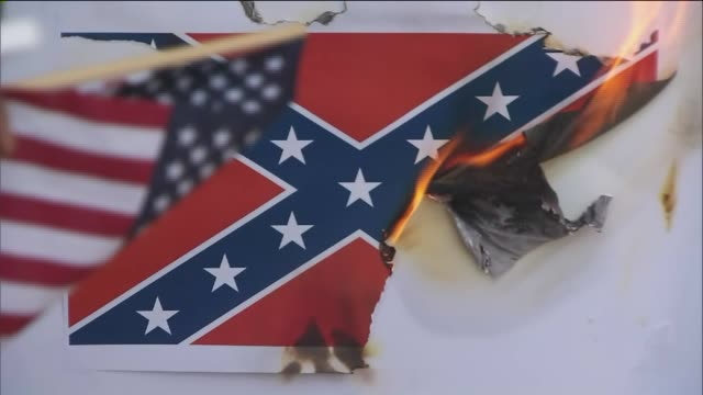 KTLA Protesters in Front Of Walmart Burning Paper Confederate Flags in the wake of the killing of African Americans at a South Carolina church