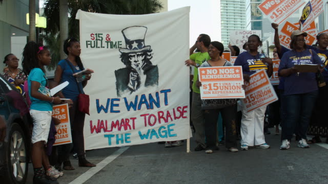 Protesters make themselves heard on tax day asking for higher wages on April 15 2015 in Miami Florida Fast food workers in cities around the United...