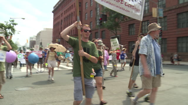 Protesters march against fracking and Cove Point in support of clean energy alternatives