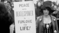 Protesters marching with placards 'They Are Our Brothers Whom We Kill' 'Black Men Should Fight White Racism Not Vietnamese Freedom Fighters' / CU...
