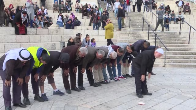 Protesters perform prayer as they gather to stage a protest against US President Donald Trumps announcement to recognize Jerusalem as the capital of...
