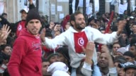 Protesters pressured Tunisia's new interim government to quit on Tuesday in the wake of president Zine El Abidine Ben Ali's departure as the cabinet...