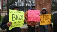 Protesters protesting United States president elect Donald Trump stand outside the Michigan University Football stadium in Ann Arbor Michigan before...