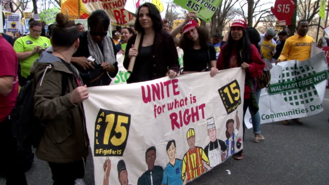 Protesters rallying in Columbus Circle demanding that the minimum wage in the United States is raised to a livable $15 an hour