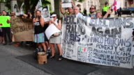Protesters with large banner or sign complaining of fraud in the Mexican elections The event took place outside Casa Loma where Pena Nieto met with...