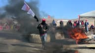 Protesting miners gather at a roadblock in Antofagasta Chile where a strike has halted production at the Escondida mine the world's biggest copper...