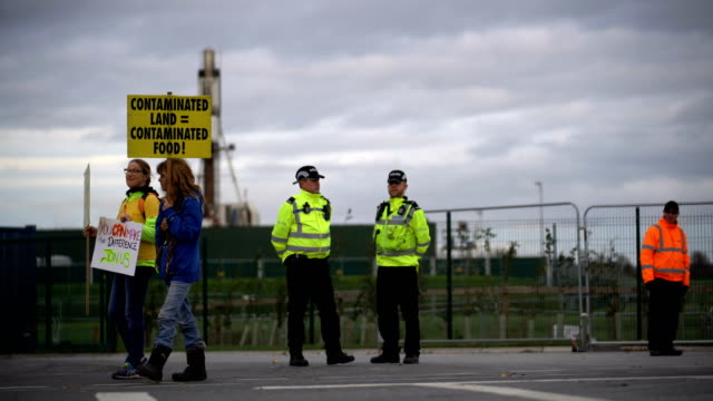 Protestors demonstrate outside Cuadrilla's shale gas fracking drilling rig near Westby on October 12 2017 in Blackpool England Engineers have begun...