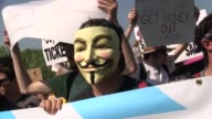 Protestors group shot on beach in front of David Koch's mansion chant 'Say No To Koch' Banner reads 'Mitt Romney Has A Koch Problem' Romney/David...