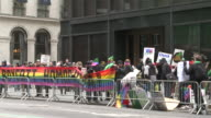 Protestors hold a sign up that reads 'Boycott Homophobia' at the New York City St Patrick's Day Parade