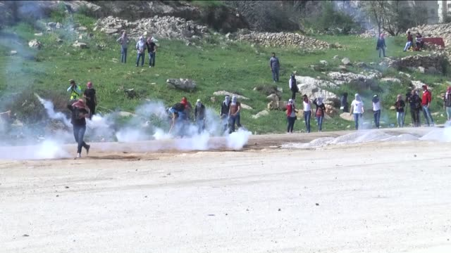 Protestors throw stones towards Israeli police officers during the clashes following the intervention of police officers into a demonstration staged...