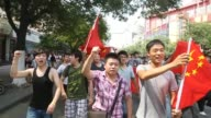 Protests against Japan break out in at least eight Chinese cities as authorities allow thousands of people to show their anger over a bitter...