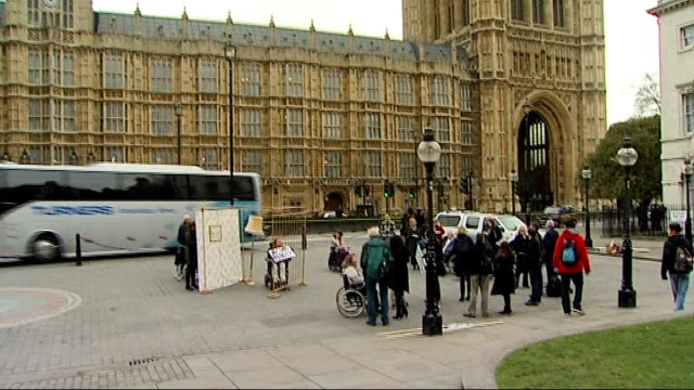 Protests against reform of the Disability Living Allowance ENGLAND London Westminster EXT GVs disabled protesters in wheelchairs holding placards...