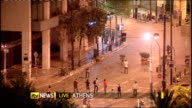 Protests and general strike against government austerity measures GREECE Athens High angle LIVE shot demonstrators throwing missiles at riot police